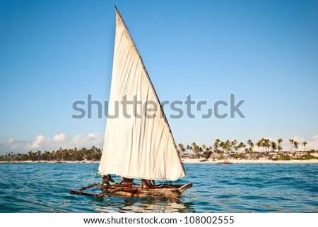 traditional boat sailing in Zanzibar - stock photo