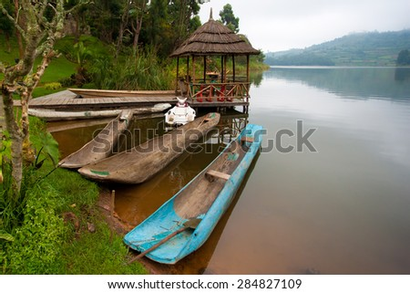 Traditional boats at Lake Bunyonyi in Uganda, Africa, at the borders of Uganda, Congo Democratic Republic and Rwanda, not far from the Bwindi National Park, home of the last mountain gorillas - stock photo