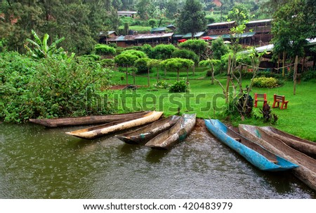 Traditional boats at Lake Bunyonyi in Uganda, Africa, at the borders of Uganda, Congo Democratic Republic and Rwanda, not far from the Bwindi National Park, home of the last mountain gorillas