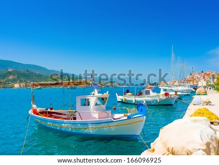 Traditional boats at Poros island in Greece - stock photo