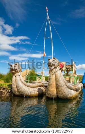 Traditional boats in the floating and tourist Islands of lake Titicaca Puno Peru South America - stock photo