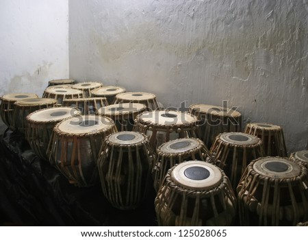 Traditional Bongo drums on vintage wall in background - stock photo
