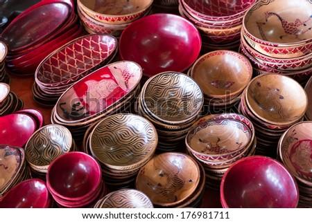 Traditional bowls with different ornament on the market, Zanzibar, Tanzania - stock photo