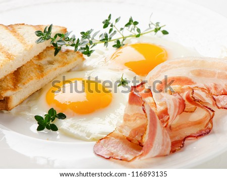Traditional breakfast -  bacon , fried eggs and toast - stock photo