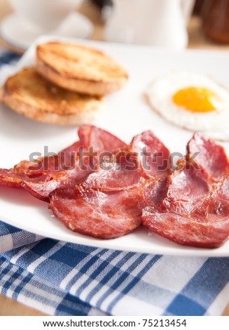 Traditional Breakfast with Canadian Bacon, English Muffin, and Fried Eggs - stock photo