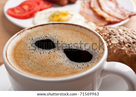 traditional breakfast with fried egg, bacon, buns and coffee - stock photo