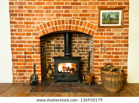 Traditional brickwork stove and fireplace. - stock photo