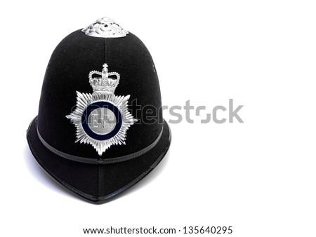 traditional british bobby police helmet on white - stock photo