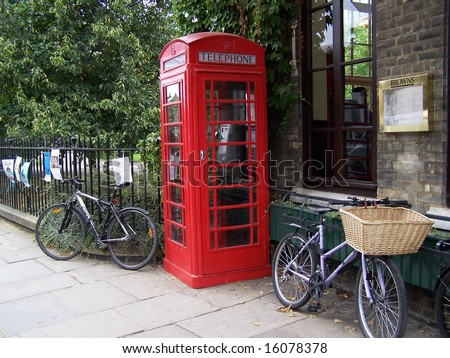 traditional British English red telephone booth K6 with bicycles in Cambridge, UK - stock photo