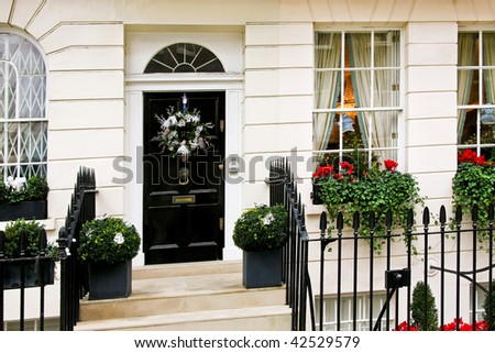 Traditional British home front with Christmas decoration - stock photo
