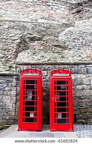 Traditional British landmark: two red telephone boxes in Edimburgh - stock photo