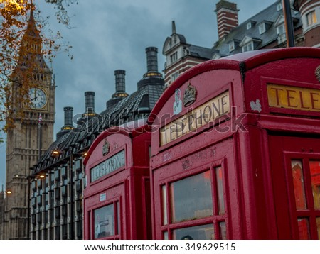 Traditional British phone booth with Big Ben in background - 6 - stock photo