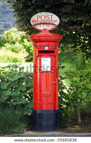 Traditional British postbox - stock photo