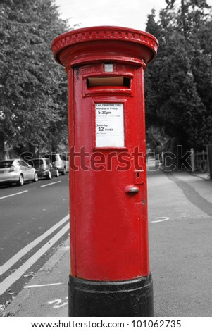 Traditional British red post box - stock photo