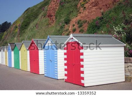 Traditional British seaside beach huts photographed at Seaton Devon England - stock photo