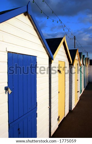 Traditional British seaside beach huts, photographed at Torquay, England - stock photo