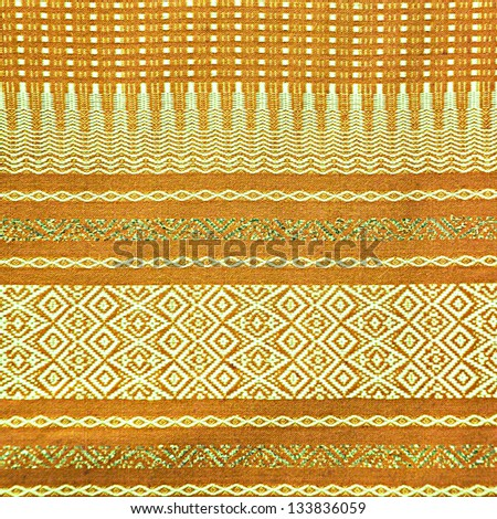 Traditional brown Thai fabric pattern as background - stock photo