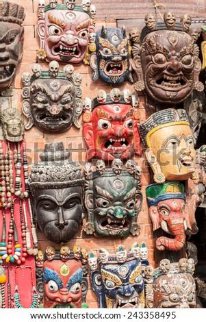 Traditional Buddhist masks in Swayambhunath, Nepal. - stock photo