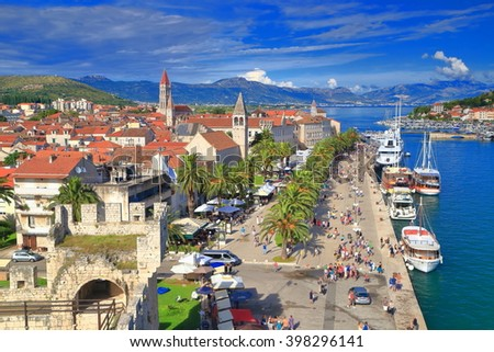 Traditional buildings along the pier of an old Venetian town near the Adriatic sea, Trogir, Croatia - stock photo