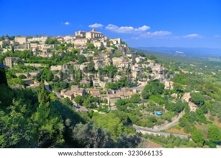 Traditional buildings spread on a green hill in historical town of  Gordes, Provence-Alpes-Cote d'Azur, France