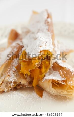 Traditional bulgarian dessert called tikvenik with filo dough and pumpkin - stock photo
