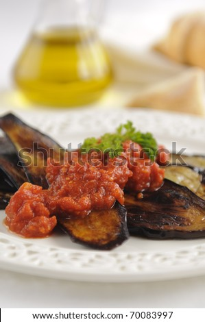 Traditional bulgarian dish - grilled eggplant with tomato sauce - stock photo