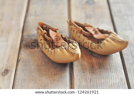 Traditional Bulgarian lather shoes - tsarvuli - stock photo