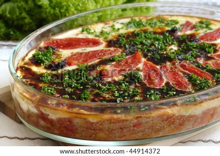 Traditional bulgarian musaka - baked vegetables under white bechamel sauce - stock photo