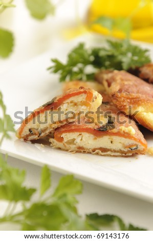 Traditional bulgarian red peppers stuffed with feta cheese and fried - stock photo