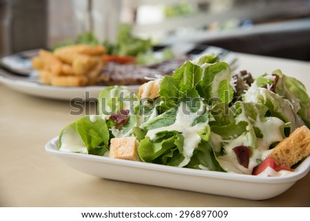 Traditional Caesar Salad with Bacon - stock photo