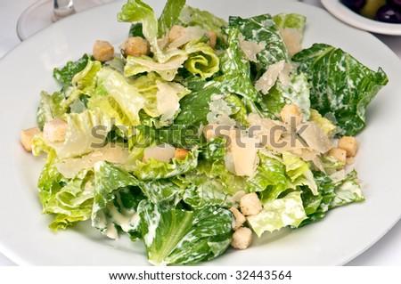 Traditional caesar salad with parmigiana crostoni. - stock photo