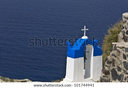 Traditional campanile at Oia village of Santorini island in Greece - stock photo