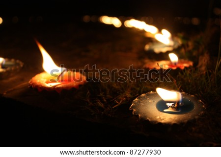 Traditional candles lit in a garden on teh occassion of Diwali festival in India.
