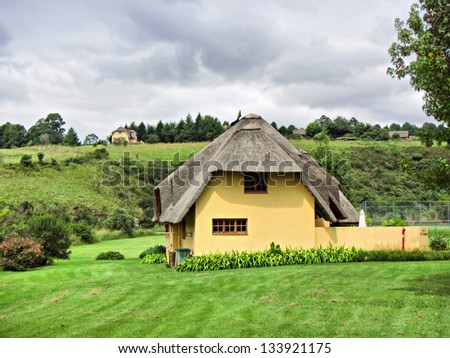 Traditional Cape Dutch vacation house. Shot in Monks Cowl area, Drakensberg Mountains, South Africa. - stock photo
