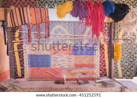 Traditional carpet loom, Morocco. - stock photo
