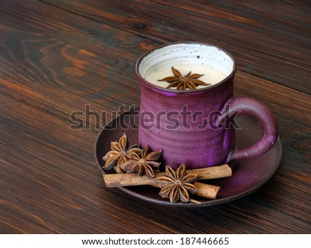 Traditional chai tea with spices and milk - stock photo