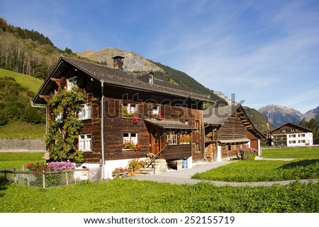 Traditional chalet in Alps regions - stock photo