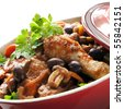 Traditional chicken cacciatore, in a red casserole dish. - stock photo