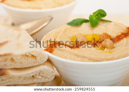 traditional chickpeas Hummus with pita bread and paprika on top  - stock photo