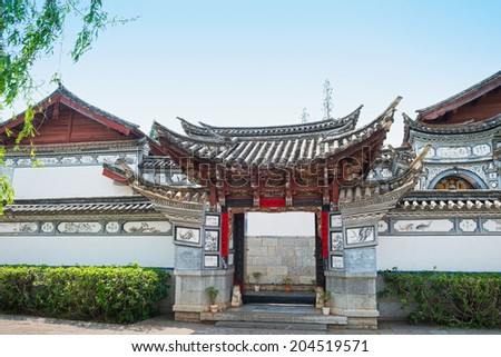 Traditional chinese building. Located in Yunnan Nationalities Village, Kunming City, Yunnan Province, China. - stock photo