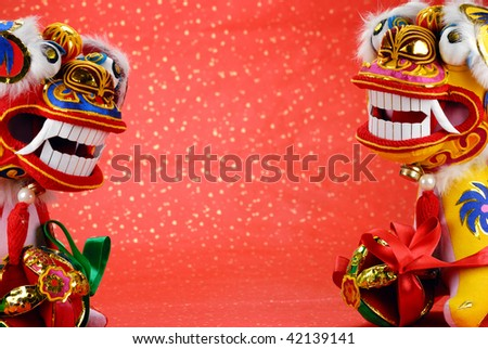 traditional chinese dancing-lion on a festive background,the lion is believed to be able to dispel evil and bring good luck and prosperity in China. - stock photo