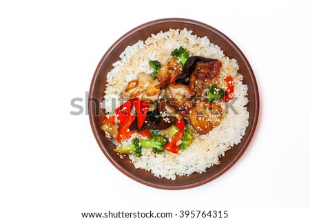 traditional Chinese dishes, rice with chicken and vegetables on a white background - stock photo