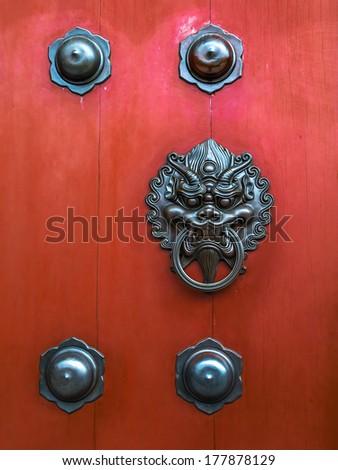 Traditional Chinese Door knocker - stock photo