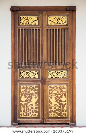 Traditional Chinese Gate ,Vintage Asian door in Penang. - stock photo