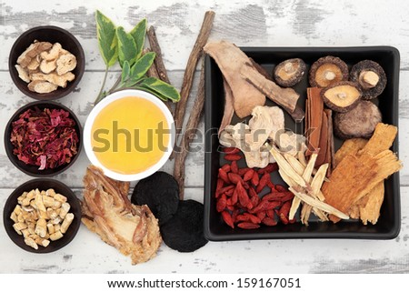 Traditional chinese herbal medicine ingredient selection with honey.  - stock photo
