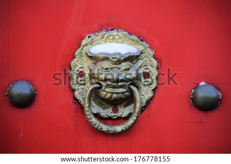 traditional Chinese knocker on the door - stock photo