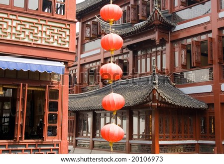 Traditional Chinese lamps and pavilions in the Yu Yuan Bazaar, popular shopping area, Shanghai, China - stock photo