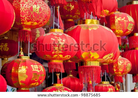 Traditional Chinese lantern hanging in the  wooden building with many chinese old style woodcarving - stock photo