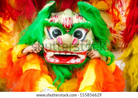 Traditional chinese lion dancing - stock photo