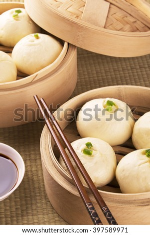 Traditional Chinese meal of baozi also known as dim sun with soy sauce - stock photo
